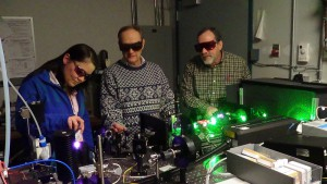 Kristin Galbally-Kinney, Steve Davis, and Terry Rawlins, of Physical Sciences Inc., adjust the excitation source for an argon microplasma laser. Kristin Galbally-Kinney, Steve Davis, and Terry Rawlins, of Physical Sciences Inc., adjust the excitation source for an argon microplasma laser. (Contributed photo)